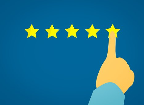 Hand choosing a five star rating as part of a target audience feedback review